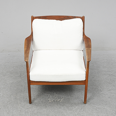 A 'usa 75' easy chair by folke ohlsson for dux, designed 1963.