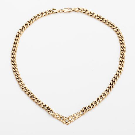 Kaulkoru, 14k kultaa, timantteja n. 0.46 ct yht. aitoustodistuksella.