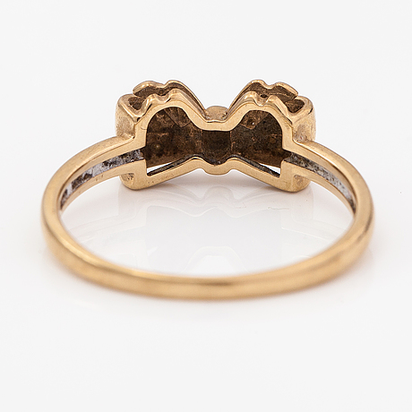 A 14k gold ring with diamonds ca. 0.005 ct in total. finland 1990.