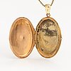 A 14k gold neacklace with a medallion.