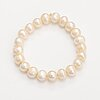A pearl collier and bracelet with cultured pearls and a metal clasp.