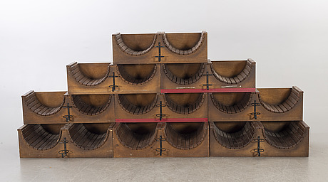 A set of nine loose wood wine racks from the turn of the century 1900/2000.
