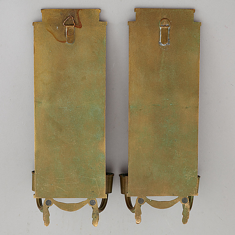 A pair of bronze wall sconces by oscar antonsson, ystad brons, from the second quarter of the 20th century.