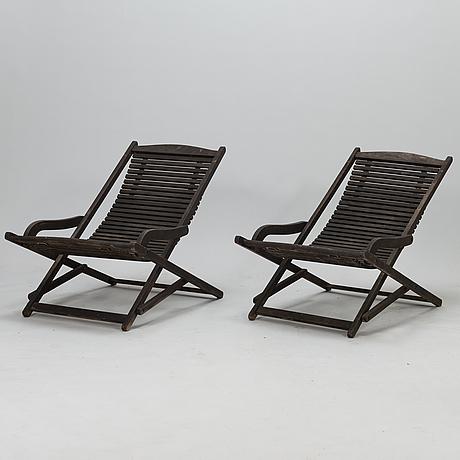 A pair of late 20th century scandinavian design jutlandia deck chairs.