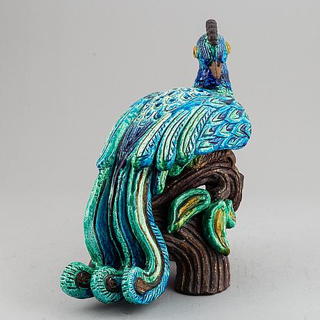 Gunnar nylund, a stoneware figurine of a peacock, rörstrand.