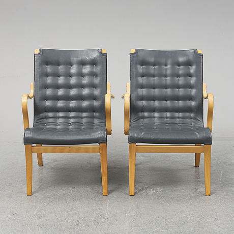 A second half of the 20th century pair of 'mina' armchairis by bruno mathsson for mathsson international.