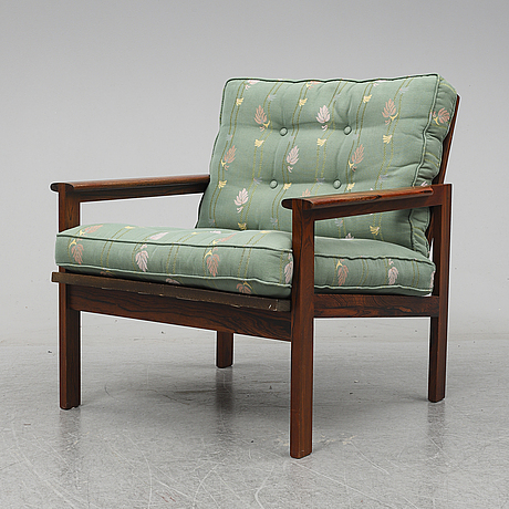 A 'capella' rosewood armchair by illum wikkelsö, designed in 1959.