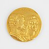 A swedish commemorative medal in 18k gold.
