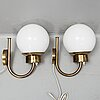 """A pair of wall lamps """"model v-118"""" in brass and glass, bergboms."""