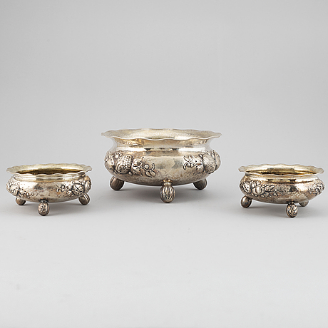 A set of three baroque style silver bowls, maker's mark cg hallberg, stockholm, 1949-1950.
