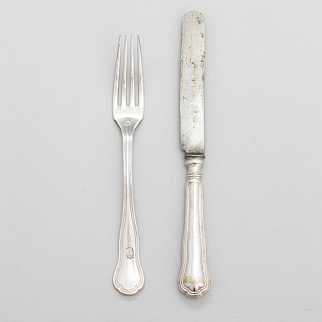A set of silver-plated cutlery, forks with engraved coat of arms, russian blades with the imperial warrant mark.
