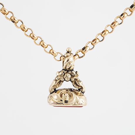 A carnelian seal in a chain.