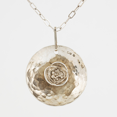 Rosa taikon a silver necklace.