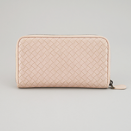 Bottega veneta, a intrecciato leather wallet.