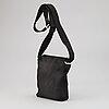 Louis vuitton, a black crossbody bag.