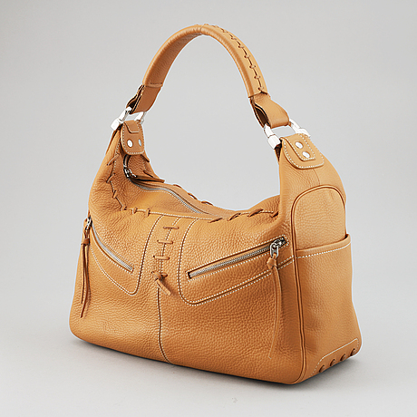 Tod's, a tan leather bag.
