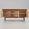 A late 20th century teak veneered sideboard.