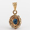 A 14k gold penadant with a sapphire and diamonds ca. 0.025 ct in total.