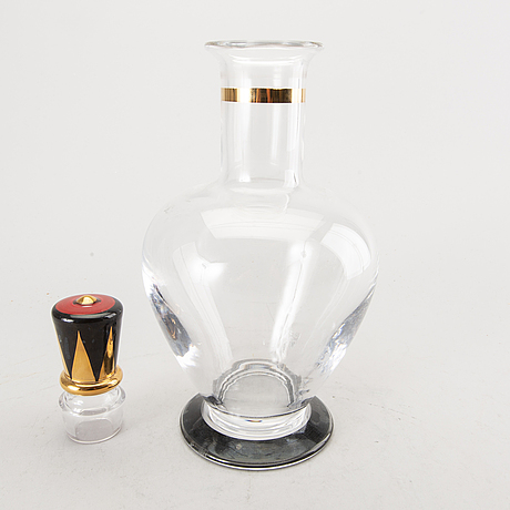 "A set of six devil glasses and a decanter ""nobel"" by gunnar cyrén for orrefors, sweden."