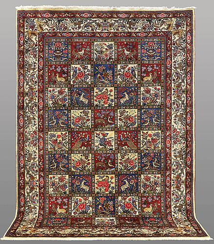 A carpet, figural baktiari, ca 303 x 207 cm.