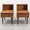 A pair of teak veneered bedside tables.