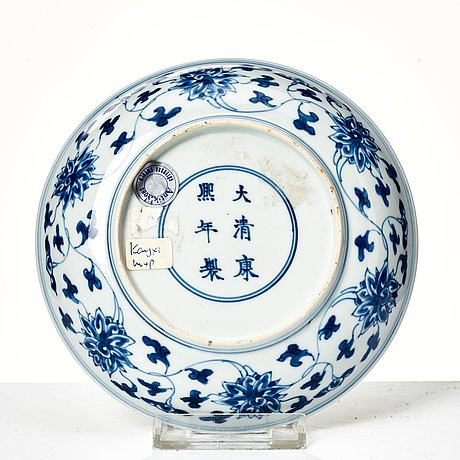 A blue and white lotus dish, qing dynasty with kangxi mark and period (1662-1722).