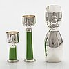 """A decanter and snapsglasses """"dudes"""" in sterling silver and glass. ru runeberg 2007."""