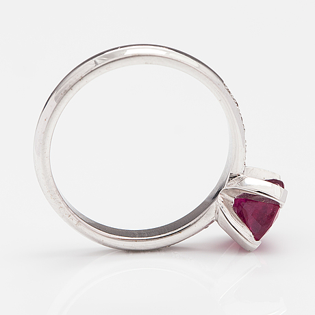 A 14k white gold ring with a ca. 1.82 ct lead glass treted ruby and diamonds ca. 0.15 ct in total.