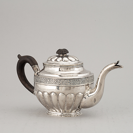 A russian 19th century parcel-gilt silver tea-pot, marked moscow 1833.