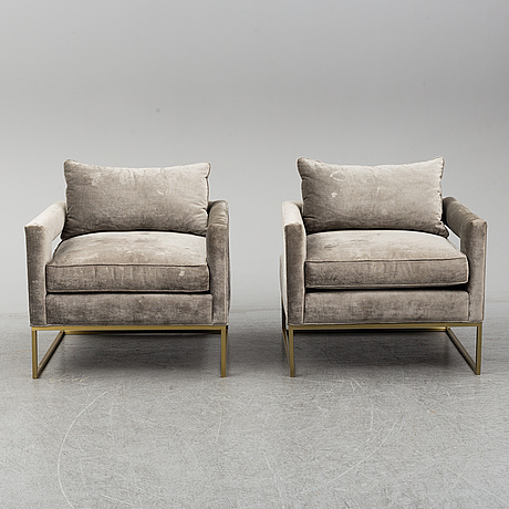 A pair of one kings lane arm chairs, 21st century.