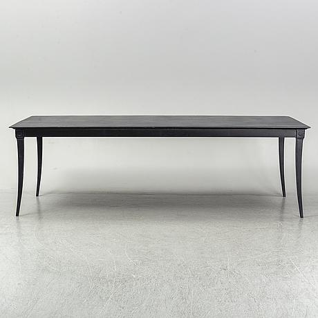 A metal restoration hardwood table, 21st century.
