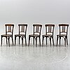 A matched set of four wooden chairs, first half of 20th century.