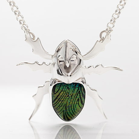 "A stelring silver necklace ""rhinoceros beetle"" with dichroic glass. ru runeberg 2019."