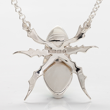 """A stelring silver necklace """"rhinoceros beetle"""" with dichroic glass. ru runeberg 2019."""