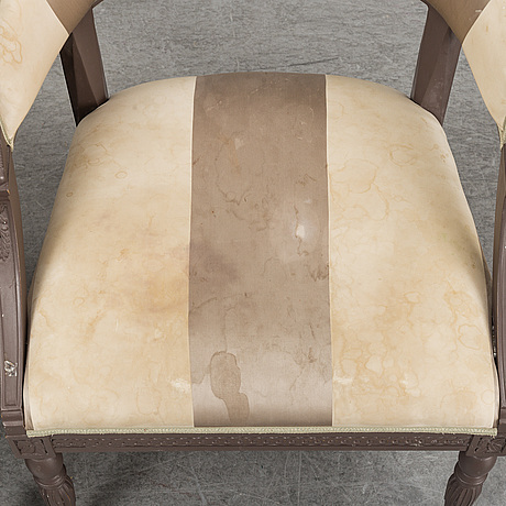 A pair of contemporary chairs in neo classical style.