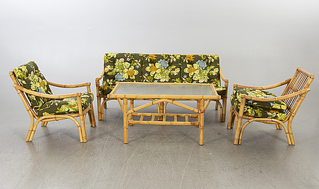 A set of ratten furniture, late 20th century; sofa, armchairs and a lounge table.