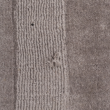 "A layered ""wool cubes"" carpet, 390x620 cm."