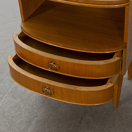 A pair of bedside tables from the mid 20th century.