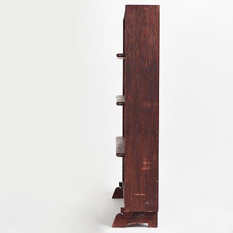 """Axel einar hjorth, a stained pine """"sport"""" bookcase, nordiska kompaniet, 1930's."""