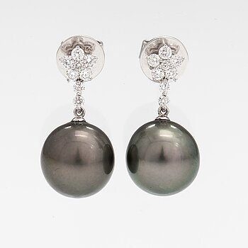 A pair of 18K white gold earrings with tahiti pearls and diamonds ca. 0.54 ct in total.