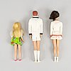 A collection of three mattel 1960's barbiedolls with accessories.