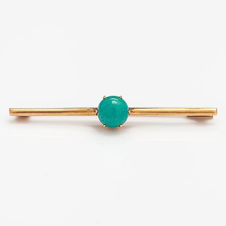 A 14k gold brooch with ar turquoise. oskar lindroos, helsinki 1955.