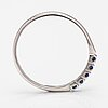 A 14k white gold ring with sapphires.