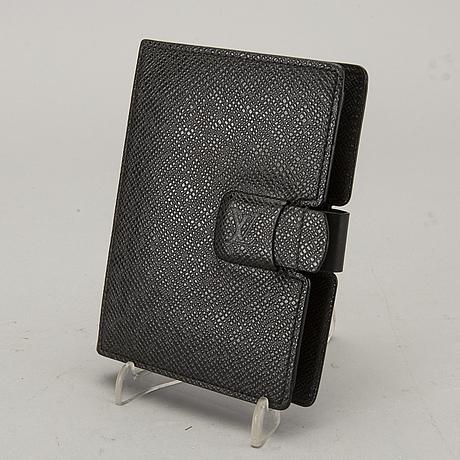 A louis vuitton palm pilot leather cover.