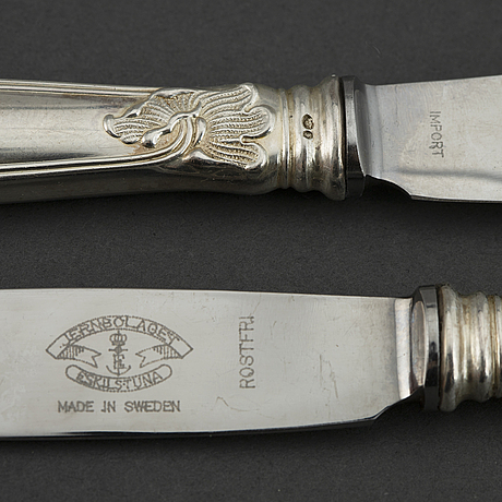 Twelve model 'sachsisk' table knives, with swedish import marks.