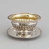 An anders lundkvist silver sauce bowl on a dish, stockholm, 1836.