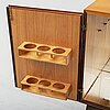 A teak and rosewood drinks cabinet, mid 20th century.