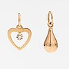 Two 14k gold pendants one with a diamond ca. 0.0025 ct.