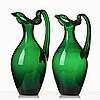 Edward hald, two emerald green claret jugs, sandvik's glassworks, sweden ca 1929, model hs 1021.