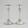 A pair of empire silver candle sticks, 1823.